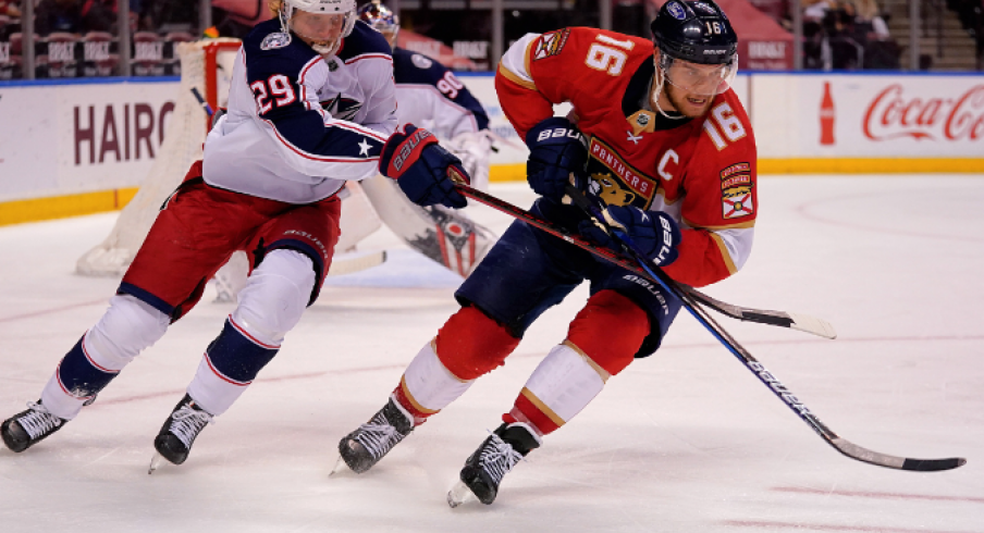 Florida Panthers center Aleksander Barkov (16) and Columbus Blue Jackets right wing Patrik Laine (29) chase a loose puck during the second period at BB&T Center.