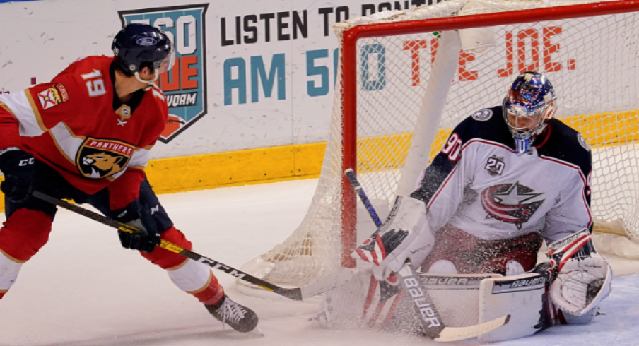 Columbus Blue Jackets goaltender Elvis Merzlikins (90) blocks the shot of Florida Panthers left wing Mason Marchment (19) during the third period at BB&T Center.
