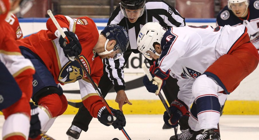 Apr 20, 2021; Sunrise, Florida, USA; Florida Panthers center Sam Bennett (9) and Columbus Blue Jackets center Jack Roslovic (96) face-off during the first period at BB&T Center.