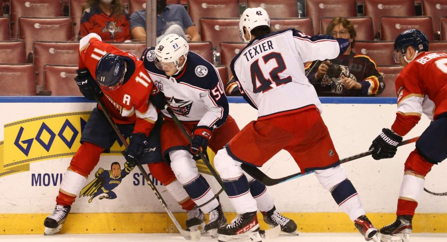 Apr 20, 2021; Sunrise, Florida, USA; Florida Panthers left wing Jonathan Huberdeau (11) protects the puck from Columbus Blue Jackets left wing Eric Robinson (50) during the third period at BB&T Center.
