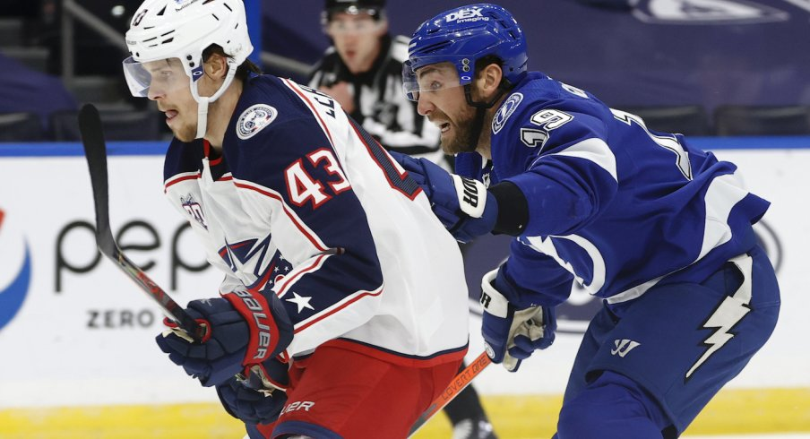 Columbus Blue Jackets defenseman Mikko Lehtonen (43) and Tampa Bay Lightning right wing Barclay Goodrow (19) skate after the puck during the first period at Amalie Arena.