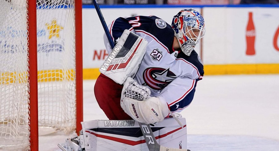 Apr 4, 2021; Sunrise, Florida, USA; Columbus Blue Jackets goaltender Joonas Korpisalo (70) blocks the puck against the Florida Panthers during the second period at BB&T Center.
