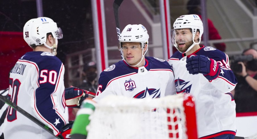 May 1, 2021; Raleigh, North Carolina, USA; Columbus Blue Jackets center Max Domi (16) is congratulated by center Boone Jenner (38) and left wing Eric Robinson (50) after scoring a first period goal against the Carolina Hurricanes at PNC Arena.