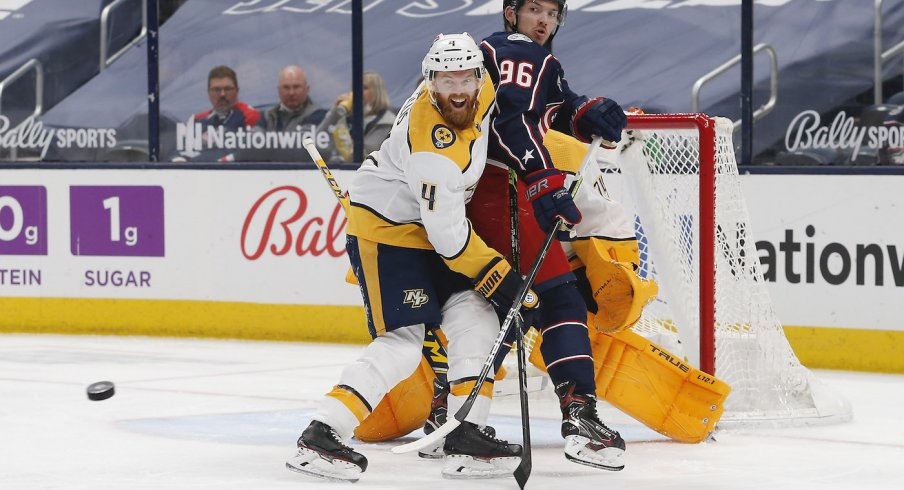 Columbus Blue Jackets center Jack Roslovic (96) and Nashville Predators defenseman Ryan Ellis (4) battle for position in front of the net during the first period at Nationwide Arena