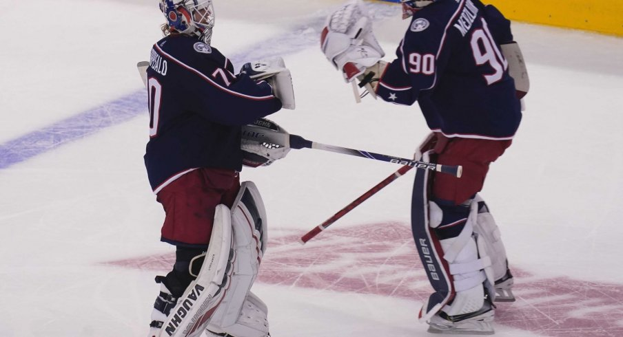 Aug 6, 2020; Toronto, Ontario, CAN; Columbus Blue Jackets goaltender Joonas Korpisalo (70) heads for the bench as he is replaced by goaltender Elvis Merzlikins (90) during the second period against the Toronto Maple Leafs in the Eastern Conference qualifications at Scotiabank Arena.
