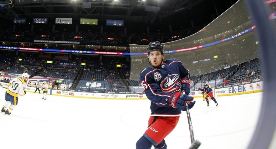 Columbus Blue Jackets center Jack Roslovic (96) passes the puck off the glass during the first period against the Nashville Predators at Nationwide Arena.