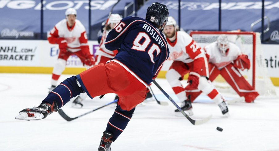 May 8, 2021; Columbus, Ohio, USA; Columbus Blue Jackets center Jack Roslovic (96) shoots and scores a goal against the Detroit Red Wings in the third period at Nationwide Arena.