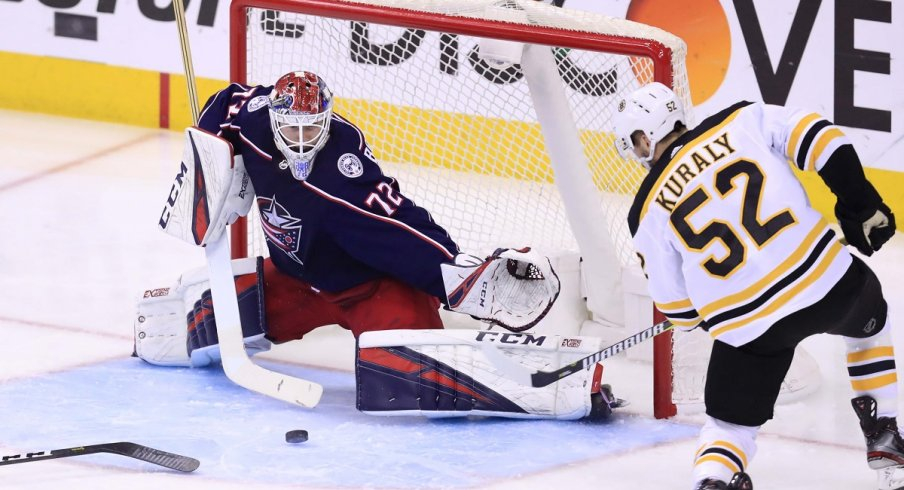 Sergei Bobrovsky makes a save against Boston Bruins center Sean Kuraly during game six of the second round of the 2019 Stanley Cup Playoffs