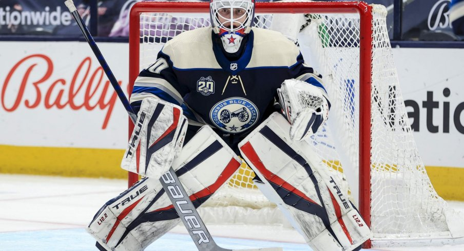 May 7, 2021; Columbus, Ohio, USA; Columbus Blue Jackets goaltender Matiss Kivlenieks (80) defends the net against the Detroit Red Wings in the second period at Nationwide Arena.