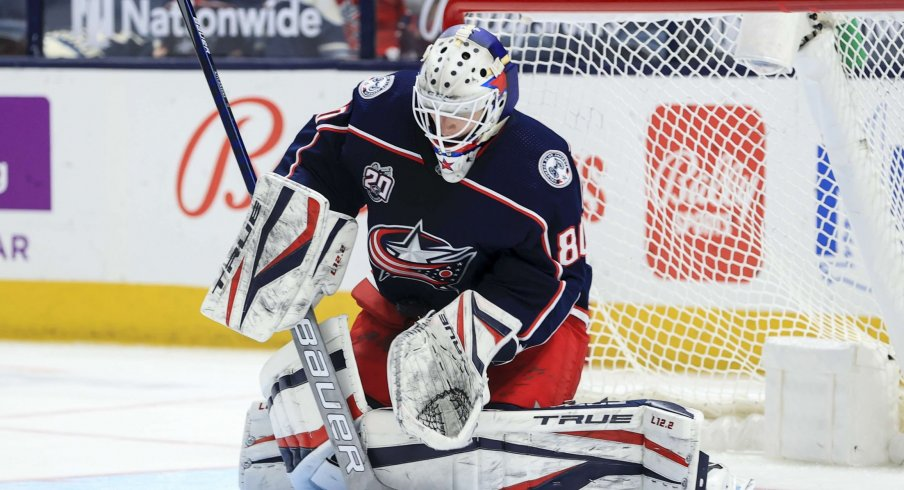 May 8, 2021; Columbus, Ohio, USA; Columbus Blue Jackets goaltender Matiss Kivlenieks (80) makes a save in net against the Detroit Red Wings in the second period at Nationwide Arena.