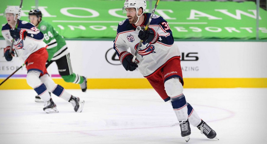 Mar 4, 2021; Dallas, Texas, USA; Columbus Blue Jackets center Boone Jenner (38) skates against the Dallas Stars during the third period at the American Airlines Center.