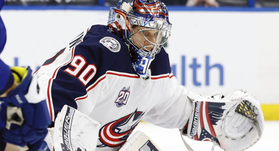 Apr 25, 2021; Tampa, Florida, USA; Columbus Blue Jackets goaltender Elvis Merzlikins (90) reacts against the Tampa Bay Lightning during the third period at Amalie Arena.