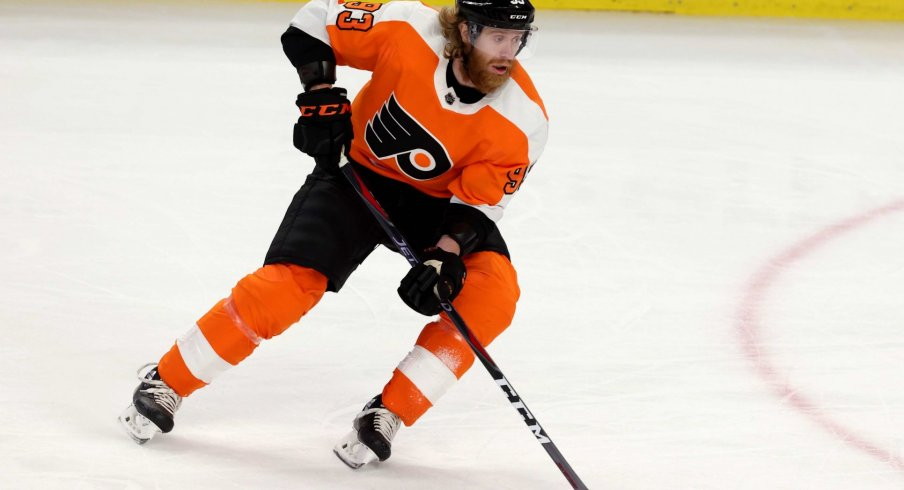 Feb 28, 2021; Buffalo, New York, USA; Philadelphia Flyers right wing Jakub Voracek (93) skates with the puck against the Buffalo Sabres during the second period at KeyBank Center.