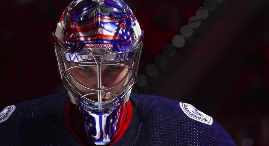 May 1, 2021; Raleigh, North Carolina, USA; Columbus Blue Jackets goaltender Elvis Merzlikins (90) gets ready for the start of the third period against the Carolina Hurricanes at PNC Arena.