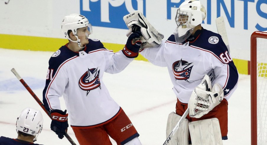 Sep 27, 2021; Pittsburgh, Pennsylvania, USA; Columbus Blue Jackets defenseman Stanislav Svozil (81) congratulates goalie Jet Greaves (60) after the Blue Jackets shutout the Pittsburgh Penguins 3-0 at PPG Paints Arena.