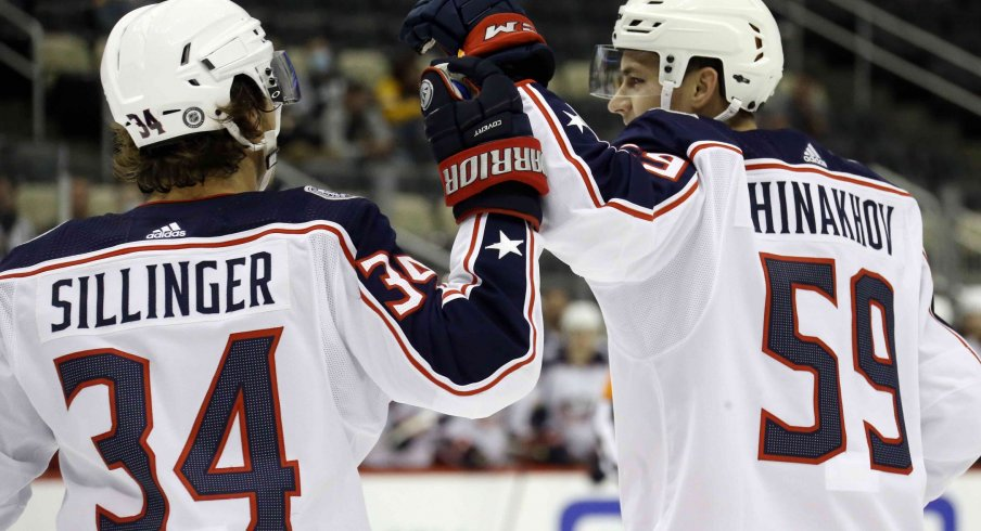 Sep 27, 2021; Pittsburgh, Pennsylvania, USA; Columbus Blue Jackets forward Yegor Chinakhov (59) celebrates with forward Cole Sillinger (34) after scoring a goal against the Pittsburgh Penguins during the first period at PPG Paints Arena.