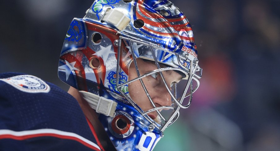 Columbus Blue Jackets goaltender Elvis Merzlikins (90) skates on the ice during a stop in play against the Chicago Blackhawks in the second period at Nationwide Arena