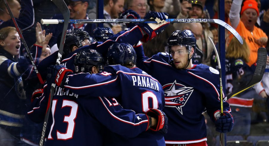 The Columbus Blue Jackets celebrate a goal scored against the Pittsburgh Penguins at Nationwide Arena.